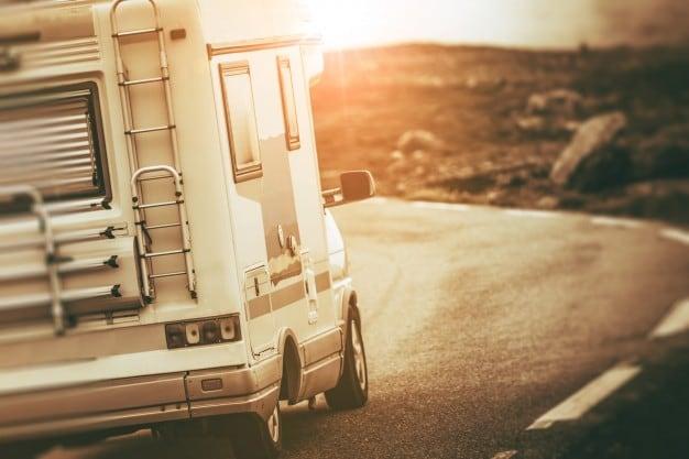 camper-van-on-the-road_1426-947